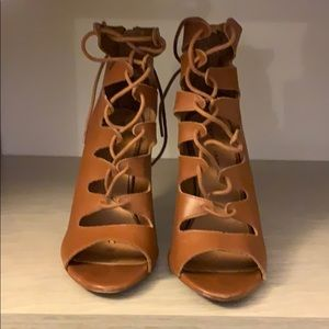 Strappy brown high heel sandals.